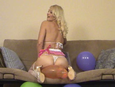 Charlee Chase blow pops balloon
