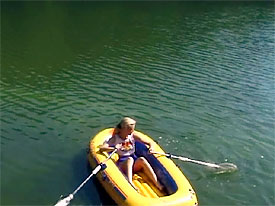 Naked girl on inflatable boat