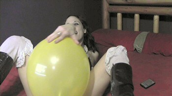 Jenn sits on balloon