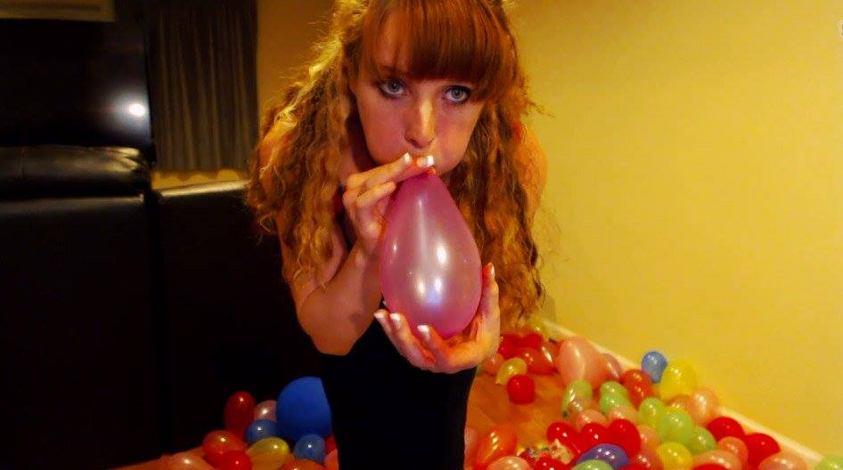 Kristy Russo blows up balloons