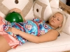 Riley Ann Winter blows balloons
